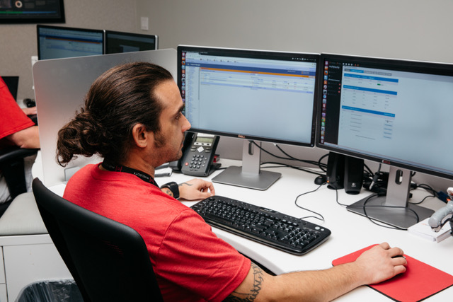 A Hivelocity employee sitting in front of a computer