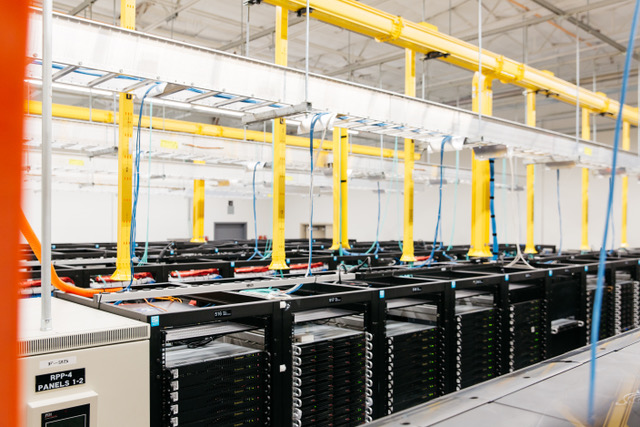 A Hivelocity data center, showing rows of filled server cabinets