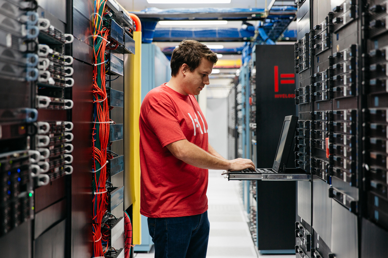 One of our highly trained and certified tech in our Tampa Data Center working on dedicated server power redundancy.